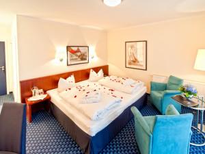 Ginster-Doppelzimmer mit Balkon im Neptun Hotel Kühlungsborn
